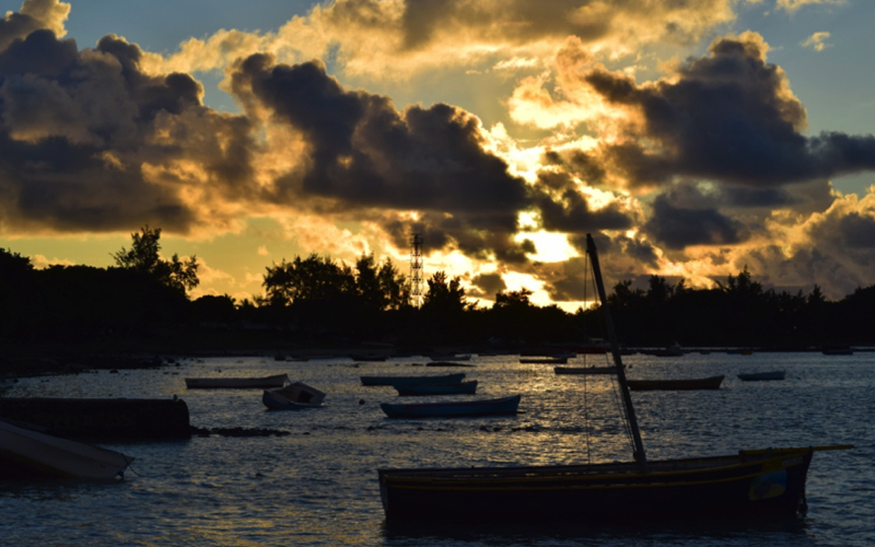 Pirogues in Mauritius at sunset